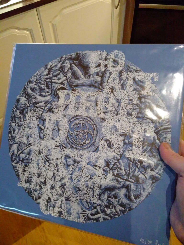 """Vinyl cover with the text """"GOA THEHE AD ST RIGHTL YPHYSI CAL"""" and the Goat The Head logo in the center."""